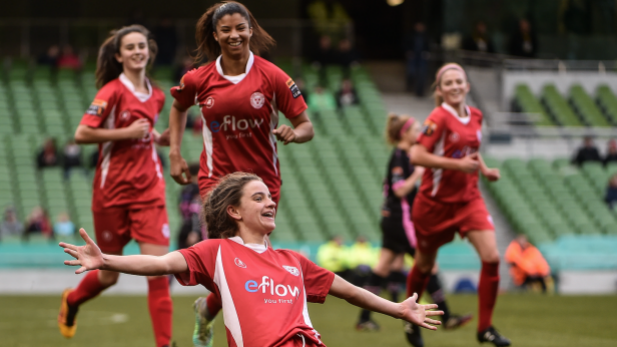 An Image of Shelbourne FC ladies winning the FAI cup.