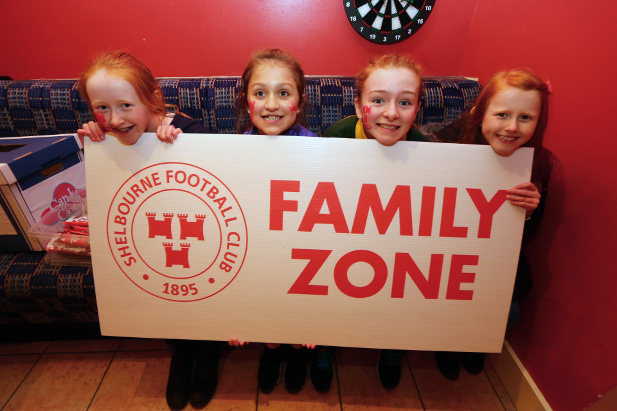 Four young Shelbourne supporters taking part in the Family Zone experience at Tolka Park.