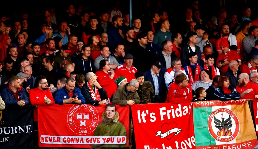 Crowd of Shelbourne FC supporters with banners at an SSE Airtricity League First Division match