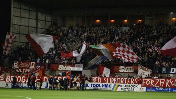 An image of fans supporting the Shelbourne FC Club at Tolka Park.
