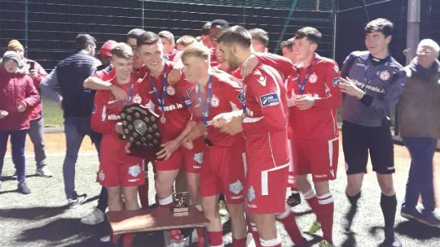 Shelbourne FC U19s team receiving the SSE Airtricity shield in October 2018.