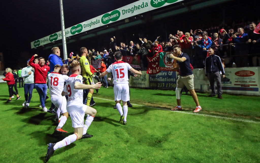 Shelbourne FC fans cheering and meeting the team.