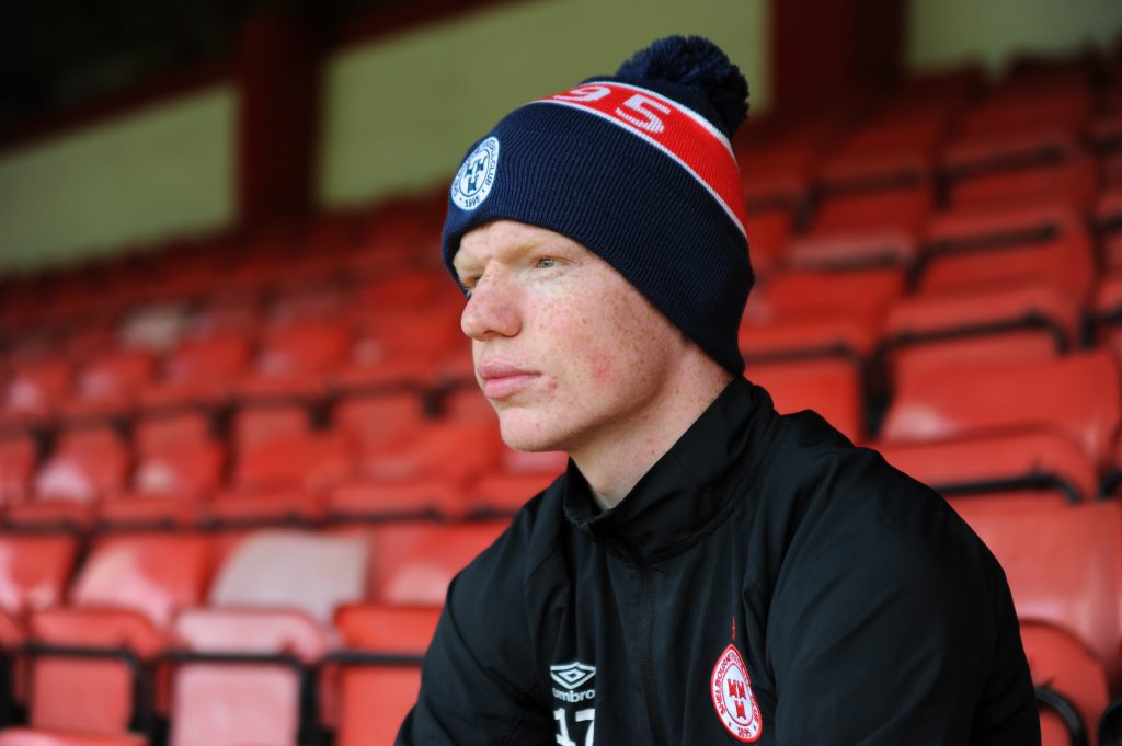 Shelbourne FC bobble hat in navy and red.