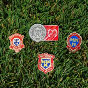Collection of Shelbourne FC pins and magnets.